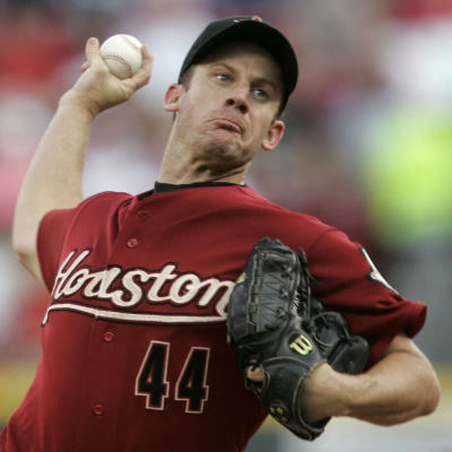 FIRST INNING: Astros starter Roy Oswalt throws against the Reds. Photo: Al Behrman, AP