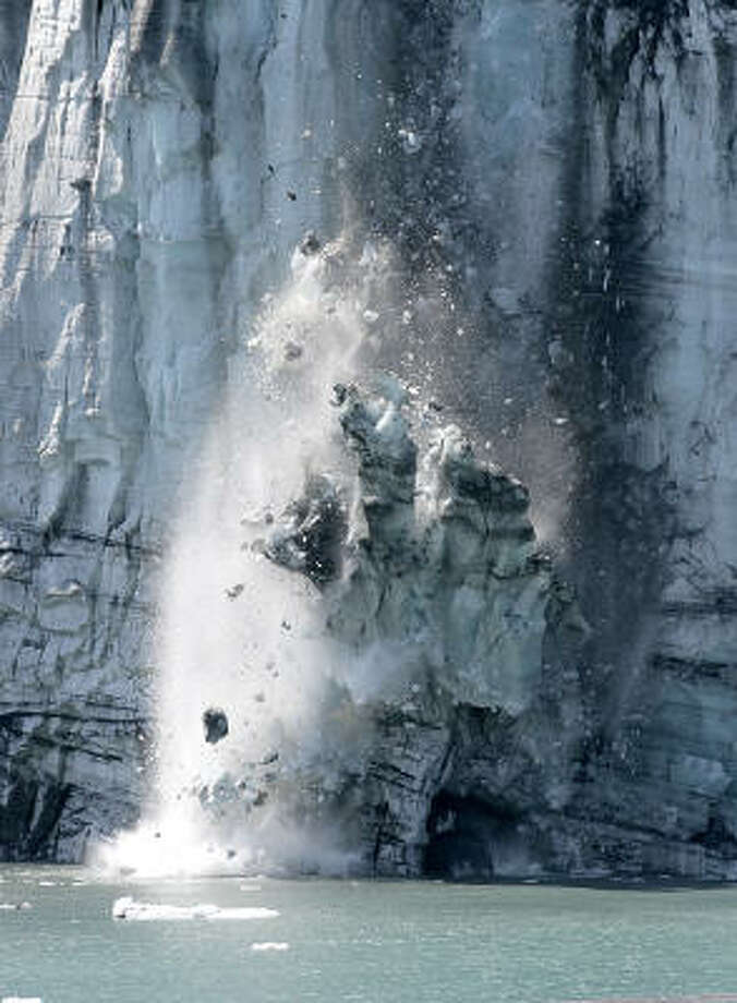 A wall of ice and rock falls from the face of Margerie Glacier in Glacier Bay National Park. Photo: DR. SCOTT M. LIEBERMAN, Associated Press