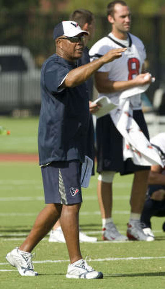 Aug. 7:Texans running backs coach Chick Harris gives his players some instruction while running plays. Photo: Brett Coomer, Chronicle