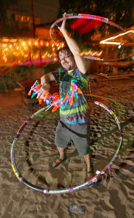 Friday is World Hoop Day, celebrating the 50th anniversary of the Hula Hoop. Patrick Spong is among the hoopers who will show off their skills at Houston's Last Concert Cafe. Photo: Bill Olive, For The Chronicle