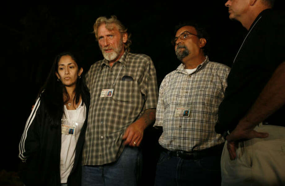 The fathers of the murdered girls speak to the media in Huntsville after Jose Medellin's execution. From left are Jennifer Ertman's best friend, Christina Alamarez, Jennifer Ertman's father, Randy Ertman and Elizabeth Pena's father, Adolfo Pena. Photo: Sharon Steinmann, Chronicle