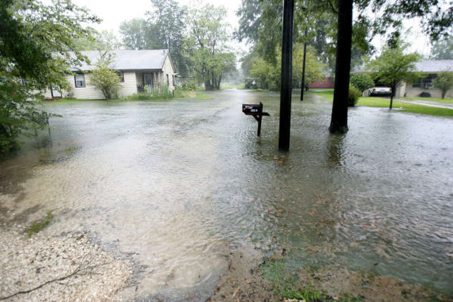 A house on Avenue C street in Channelview, had flood waters nearly surrounding it. Photo: Karen Warren, Chronicle