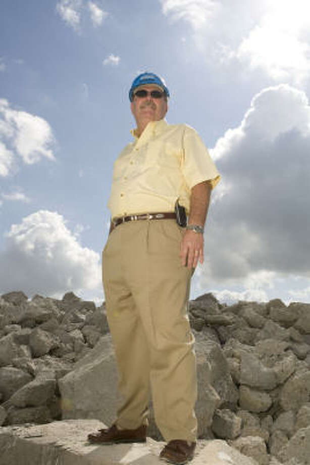 Owner Leonard Cherry looks out at the company's yard at  616 Almeda Road. Photo: James Nielsen, Chronicle