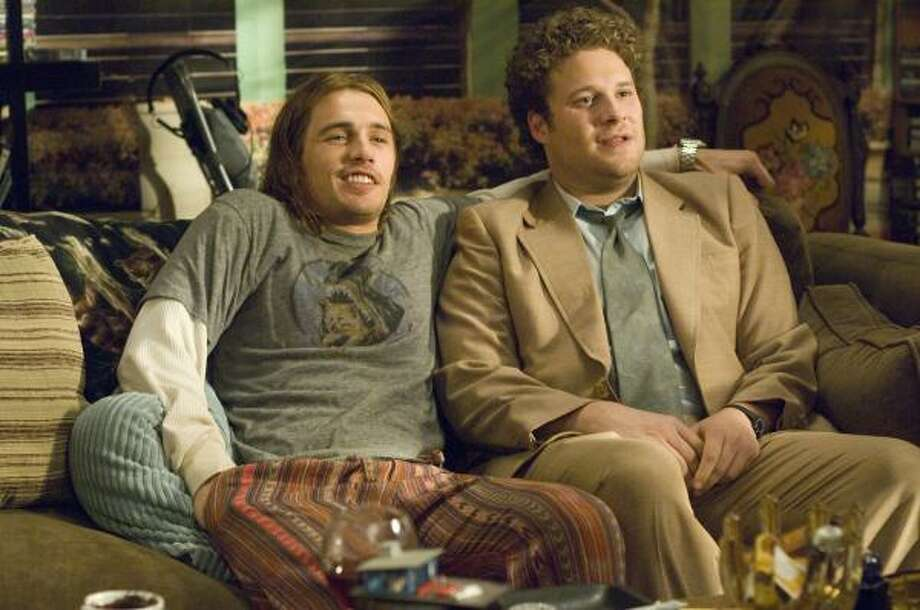 Pineapple Express: James Franco, left, and Seth Rogen play stoners on the run in the new action-comedy. Photo: Darren Michaels, AP