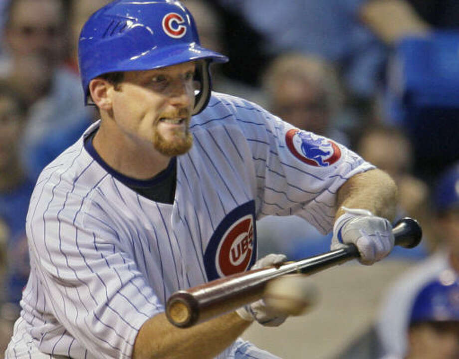 Chicago Cubs' Ryan Dempster hits a sacrifice bunt to advance Ronny Cedeno to second. Photo: M. Spencer Green, AP