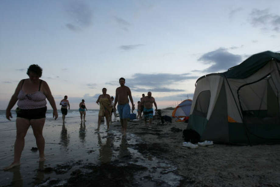 Shawna Thomas of Silsbee (left) with her family and friends prepare to spend the night camping on a beach near High Island, before tropical storm Edouard hits land. Photo: Johnny Hanson, Chronicle