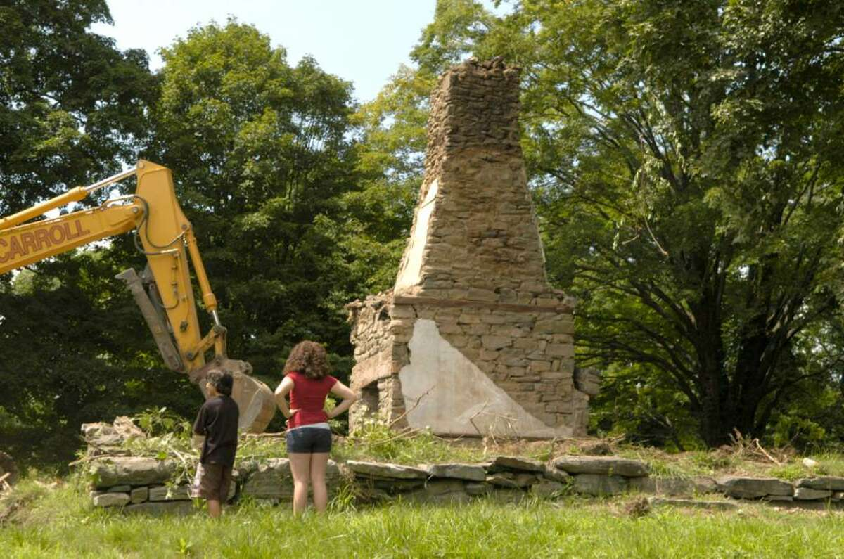 Carol Kaliff/staff photographer. Kyle Interdonato, 12, left and Caitlin Keeler, 19 look at what's left of the Nehemiah Keeler House in Ridgefield after it was torn down. Photo taken August 6, 2009
