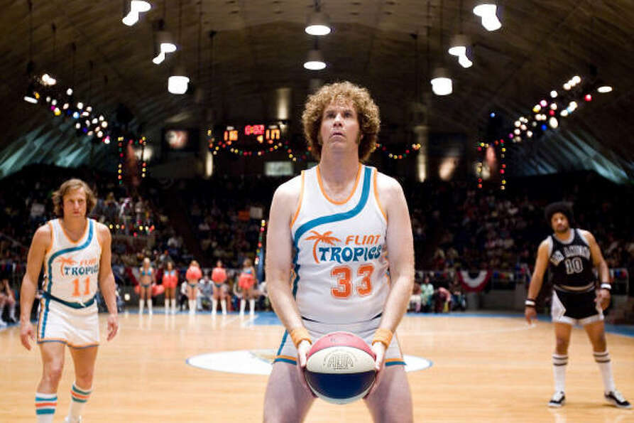 Woody Harrelson (left) stars as Ed Monix and Will Ferrell (center) stars as Jackie Moon in New Line