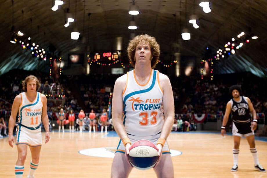"Woody Harrelson (left) stars as Ed Monix and Will Ferrell (center) stars as Jackie Moon in New Line Cinema's comedy, ""Semi-Pro."" The characters play for the Flint TROPICS, a team that never gets an opportunity to join the NBA. Photo: Handout, MCT"