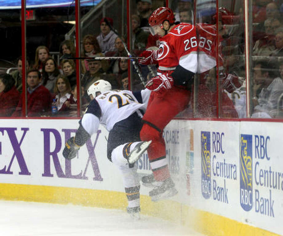 In this file photo, Atlanta Thrashers' Niclas Havelid checks Carolina HURRICANES' Erik Cole during second period action at the RBC Center on Wednesday, January 2, 2008. Atlanta won 5-4 in overtime. Photo: Jason Arthurs, MCT