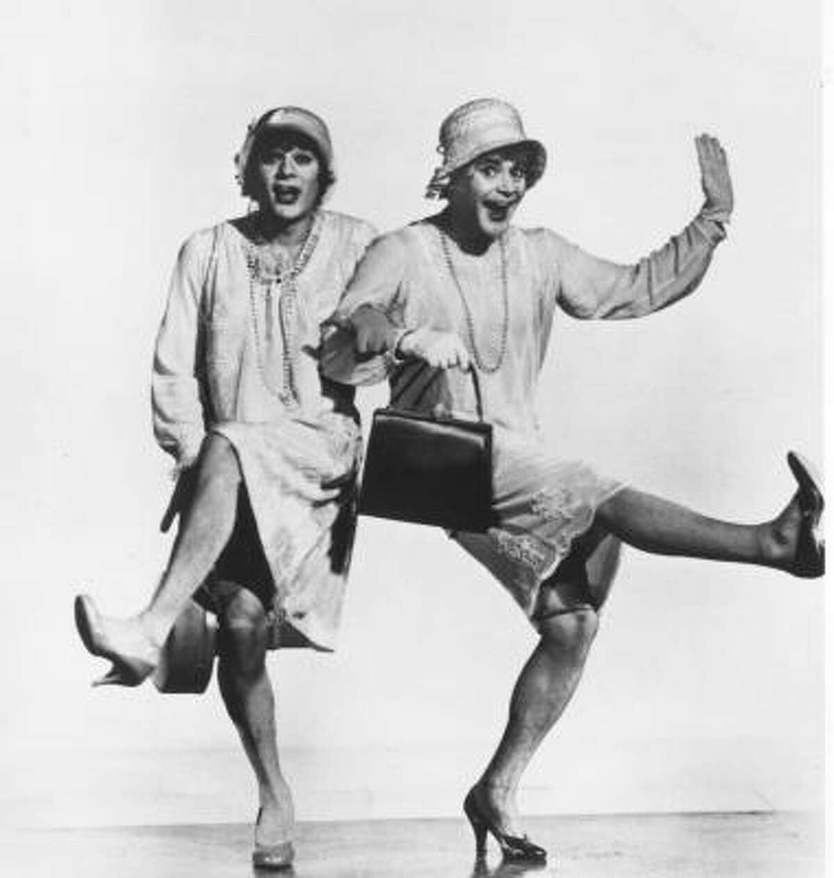 Tony Curtis (left) and Jack Lemmon star alongside Marilyn Monroe in the 1959 film,