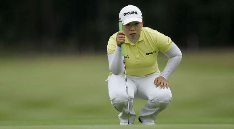 Korea's Ji-Yai Shin looks at her putt on the 16th green during her final round at the Women's British Open. Shin won the tournament with a final score of 18 under par. Photo: ALASTAIR GRANT, AP