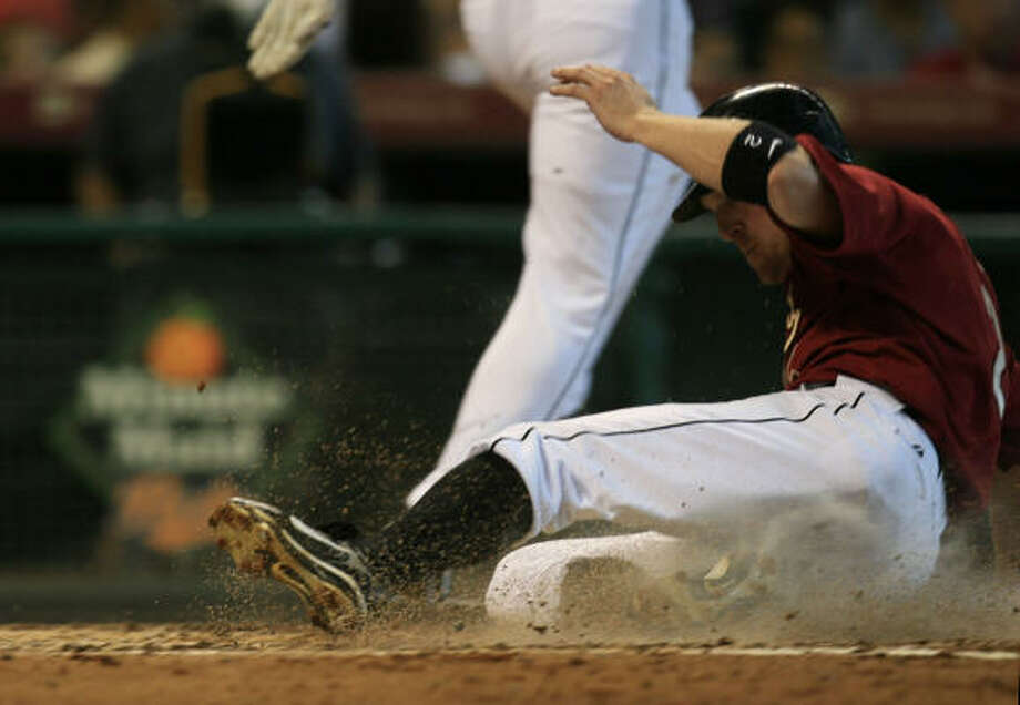 FOURTH INNING: Darin Erstad slides home safely to give the Astros a 3-0 lead. He scored on Humberto Quintero's double. Photo: Eric Kayne, Chronicle