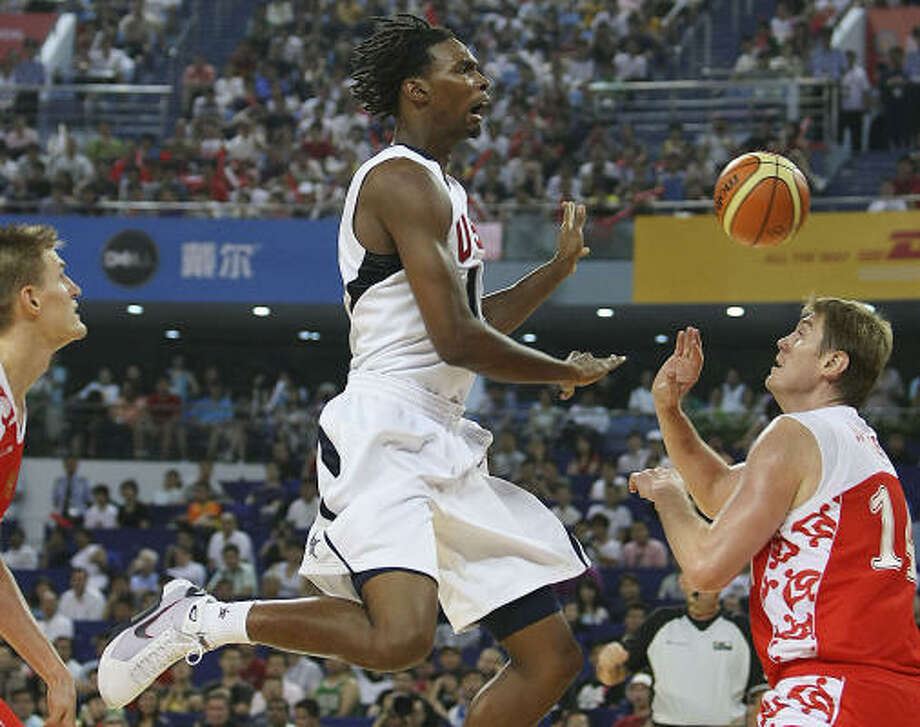Team's USA men's basketball team player Chris Bosh reacts after failing to score during a drive against Russian players. Photo: Eugene Hoshiko, AP