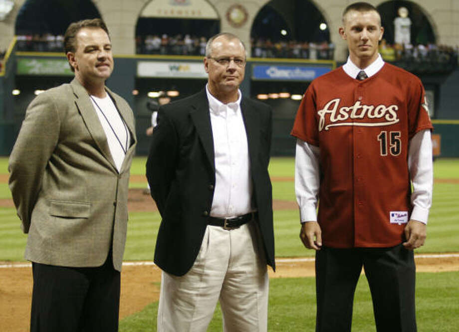 Astros Director of Amateur Scouting Bobby Heck, left, and local area scout  Rusty Pendergrass present the third-round supplemental draft pick RHP Ross Seaton from Second Baptist High School to the Astros fans during the Astros-New York Mets game at Minute Maid Park on Friday. The Astros signed Seaton earlier in the day. Photo: Leonardo Carrizo, Chronicle