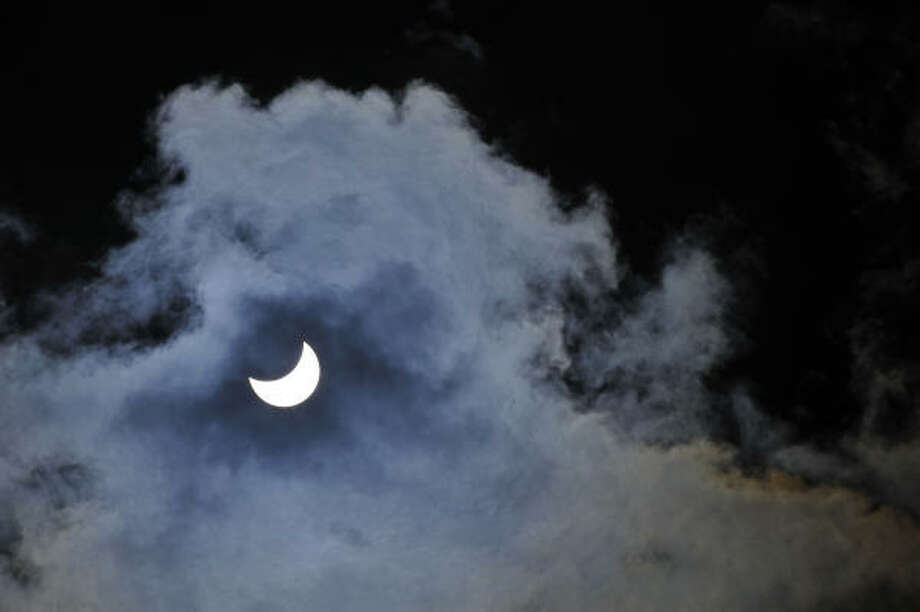 The sun is blocked during an eclipse in Nizhny Novgorod on Aug. 1 in Siberia. Photo: MIKHAIL MORDASOV, AFP/Getty Images