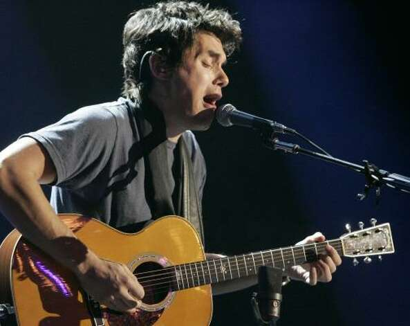 John Mayer plays guitar during a performance in Los Angeles. Photo: Dan Steinberg, Associated Press