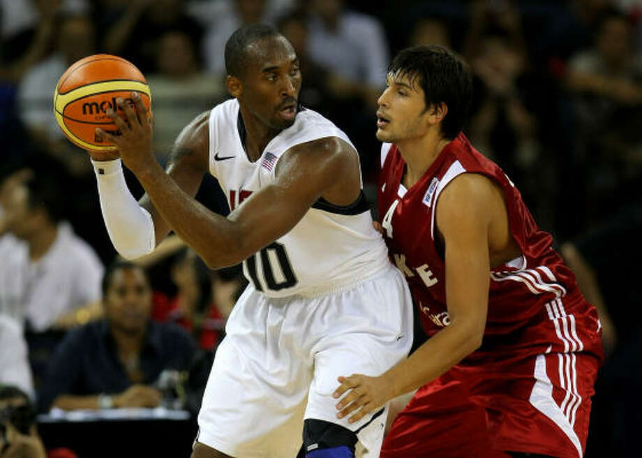USA 114, Turkey 82: Kobe Bryant holds off a Turkish defender as the U.S. rolled to victory at the Venetian Hotel in Macau, China on Thursday. USA basketball will open Olympic play August 10th against Yao Ming and the Chinese National Team. Photo: Stu Forster, Getty Images