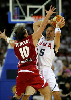 Jason Kidd feels the pressure from Turky defender Kerem Tunceri. The Americans yielded an alarming number of open shots and offensive rebounds for most of the first half and committed 10 turnovers. Photo: Stu Forster, Getty Images