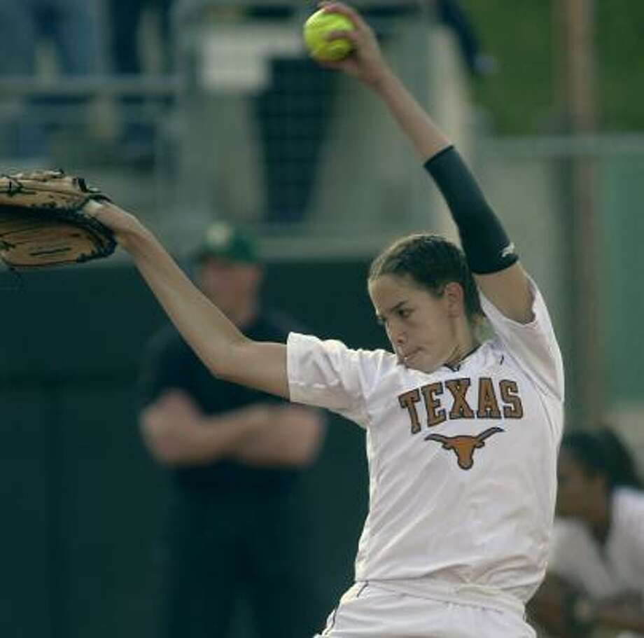 Cat Osterman threw the first perfect game  in UT history. She is now a member of the Texas Sports Hall of Fame. Photo: HARRY CABLUCK, AP