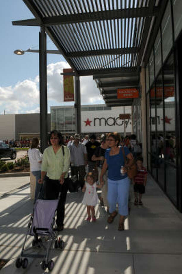Shoppers walk through Pearland Town Center during its grand opening. Photo: Kim Christensen, For The Chronicle