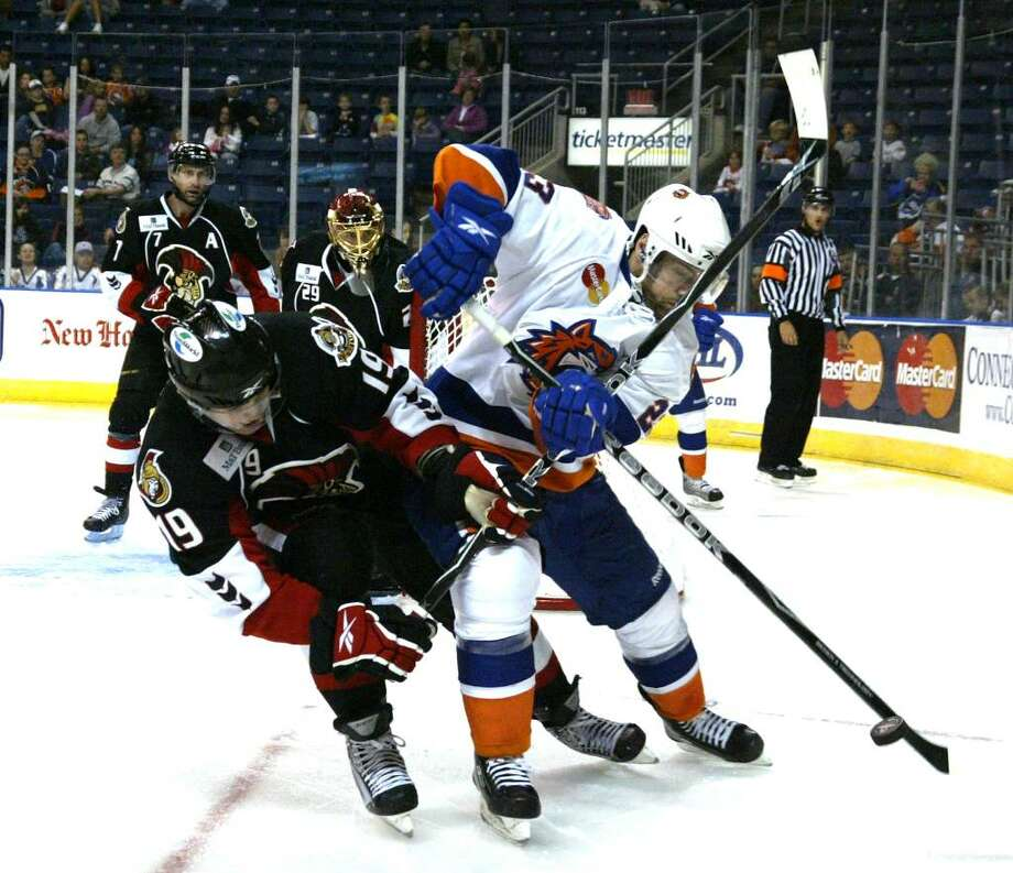 During 3rd period action at Harboryard in Bridgeport, Soundtigers forward Trevor Smith fights to control the puck against Binghamton forward  Zack Smith in the Binghamton zone, Monday, Oct 12, 2009. Photo: Phil Noel / Connecticut Post