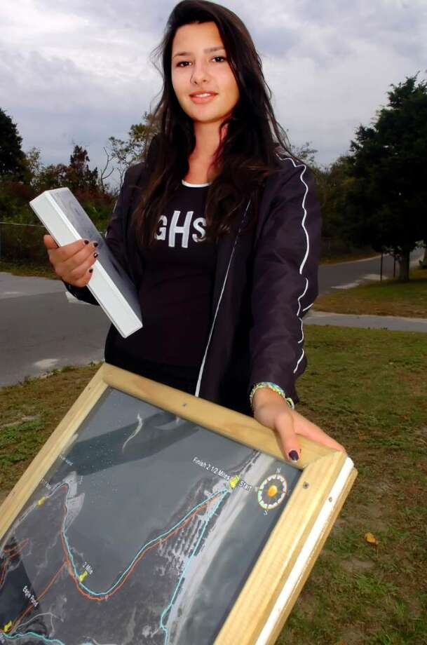 Greenwich Point, Oct. 12, 2009.   A GHS senior and Girl Scout, Gina Capoccia, 17, created trail markers and a map at Greenwich Point for runners and walkers as part of a project.  She holds her project book. The project will earn her a Girls Scout gold medal, which is comparable to the Eagle statis for Boy Scouts. Photo: Helen Neafsey / Greenwich Time