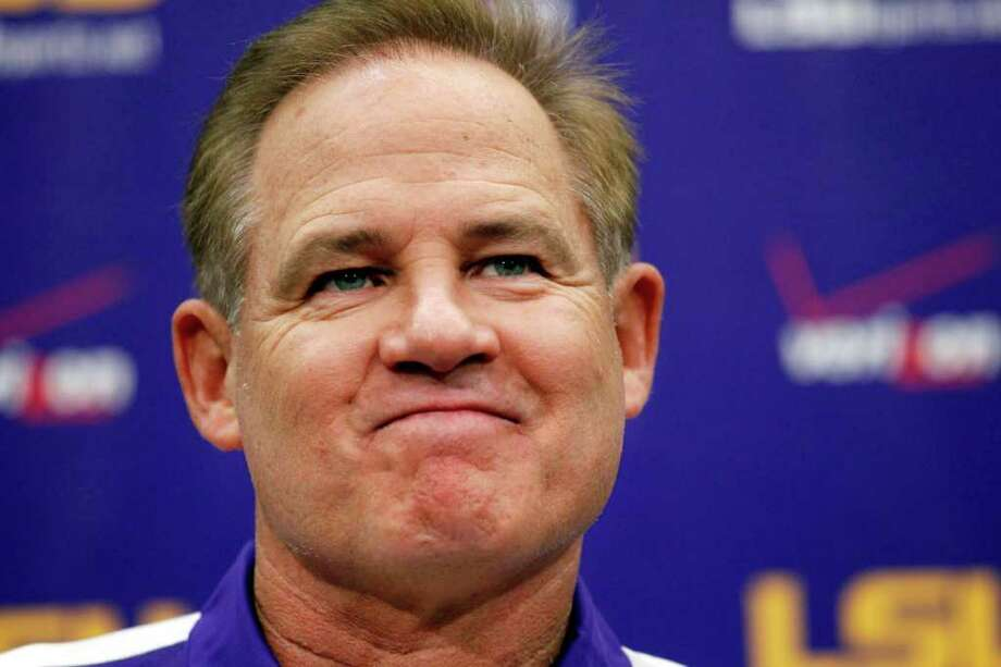 LSU head coach Les Miles talks during a news conference at NCAA college football media day  in Baton Rouge, La., Tuesday, Aug. 9, 2011. (AP Photo/Gerald Herbert) Photo: Gerald Herbert / AP