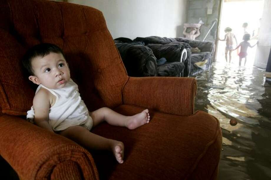 FRIDAY, JULY 25, 2008Juan Carlos Gonzalez, 8 months, sits in his aunt's living room in Colonia Porsaldo, Edinburg. Photo: Kristen Luce, The Monitor