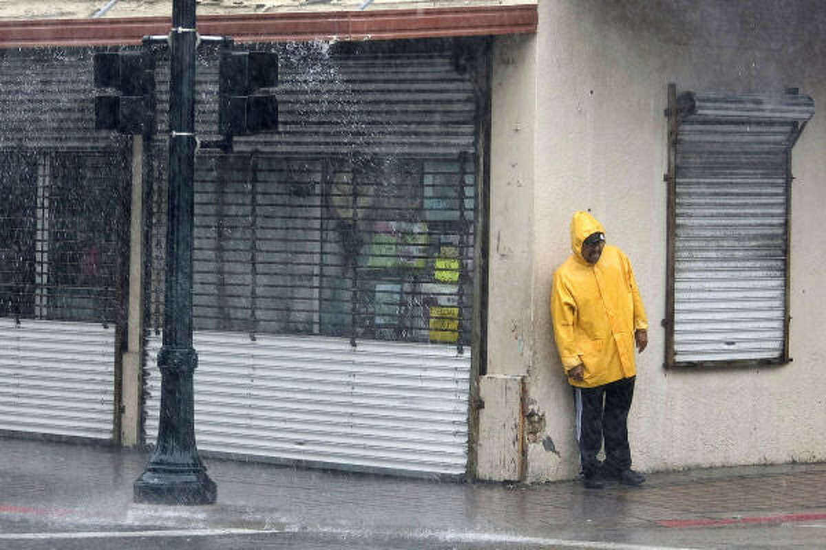 Poorest cities: Brownsville, Texas: A man stands out of the wind during a downpour in downtown Brownsville.