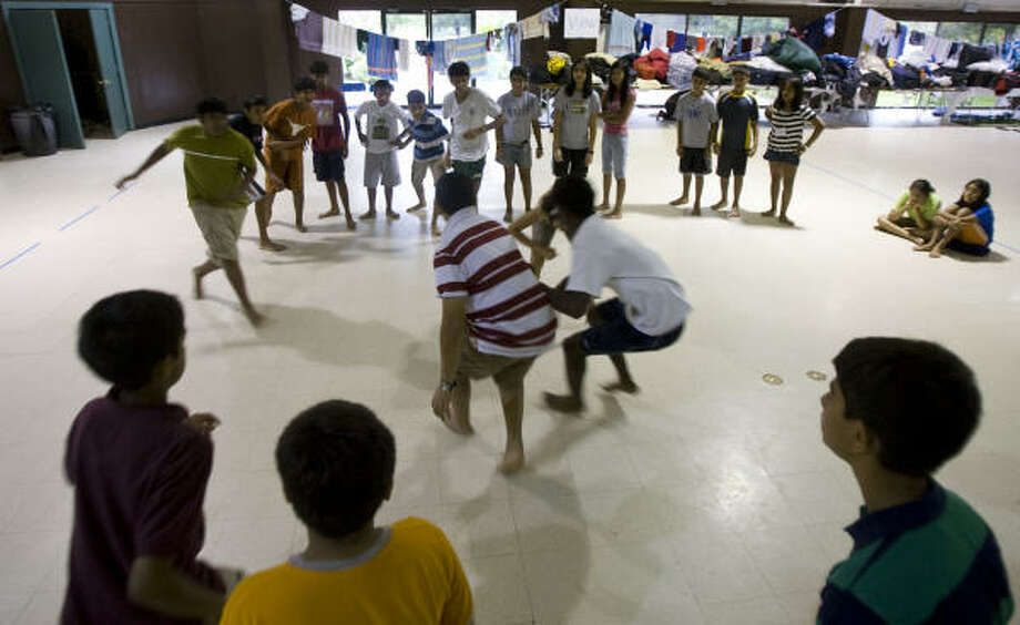 """Camp attendees play a game of """"Steal the Butter"""" during the Hindu Heritage Youth Camp at Gordon Ranch on Thursday, July 24, in Richmond. Photo: James Nielsen, Chronicle"""