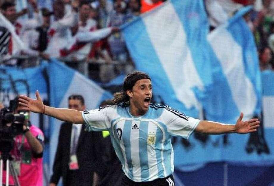 Argentinian forward Hernan Crespo celebrates after scoring against the Ivory Coast. Photo: JOHN MACDOUGALL, AFP