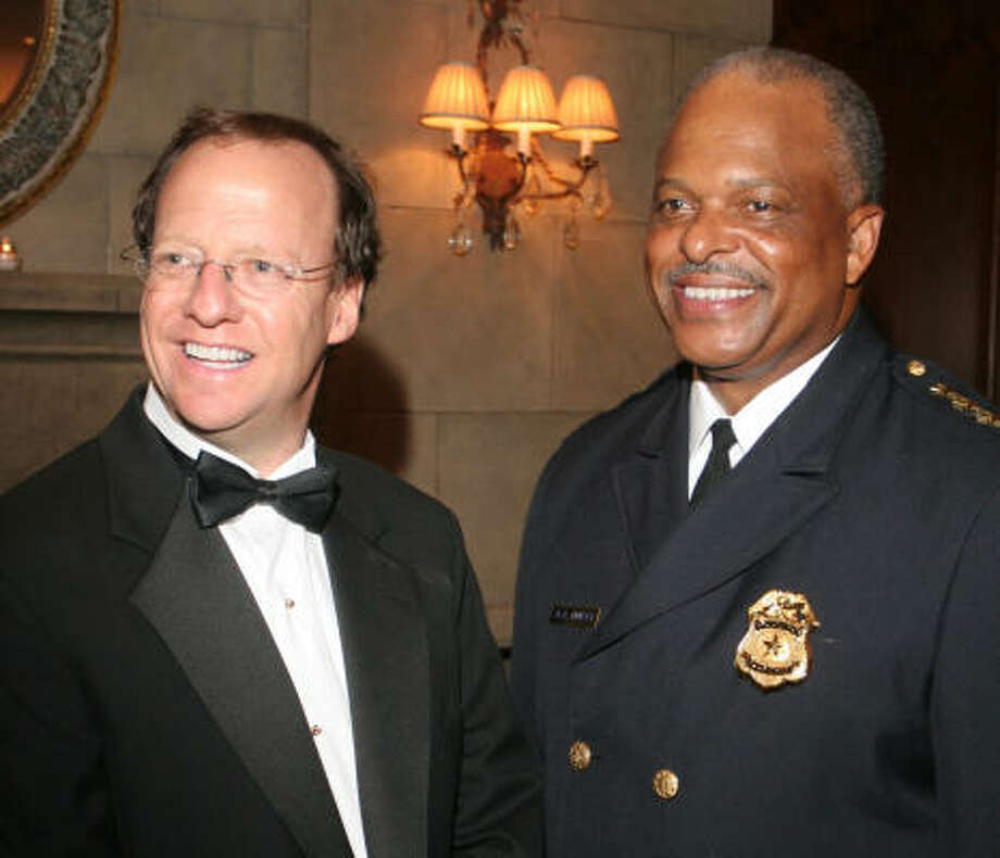Alan Helfman and Police Chief Harold Hurtt attend the first Policeman's Ball benefiting the Texas Gulf Coast chapter of the Leukemia and Lymphoma Society. Photo: Gary Fountain, For The Chronicle