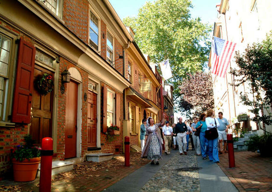 Elfreth's Alley is the oldest, continuously occupied residential street in the United States, but it's just one of the many cobblestone streets that make a walking tour of  Philadelphia's historic district worthwhile. Photo: Edward Savaria Jr., Philadelphia Convention & Visitors Bureau