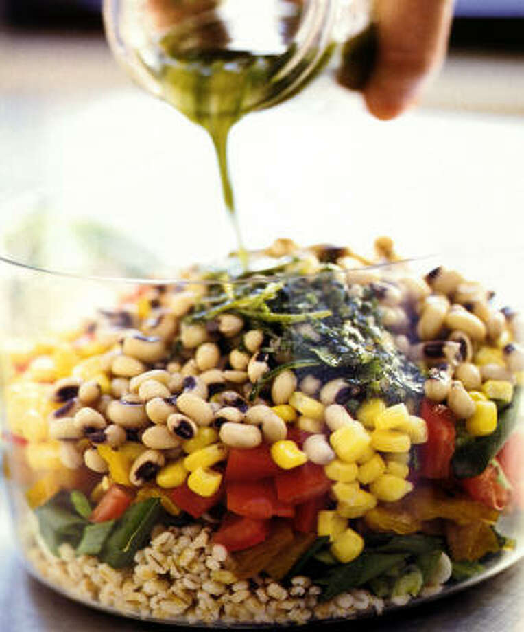An herby lime vinaigrette adds zest to Barley and Black-Eyed Pea Salad. Photo:  MARK THOMAS, Associated Press