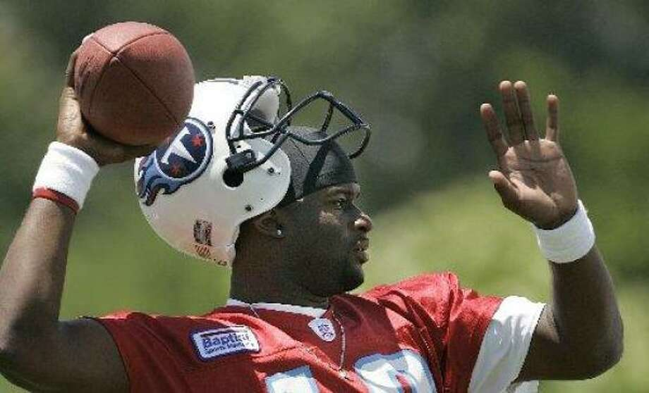 Titans quarterback Vince Young throws during a minicamp workout  in Nashville, Tenn. Photo: Mark Humphrey, AP
