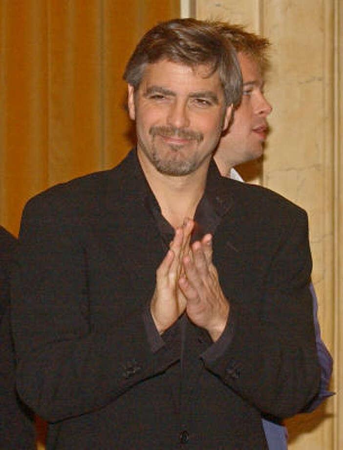 George Clooney donned the cape in 1997's 'Batman & Robin.' Photo: PLINIO  LEPRI, AP