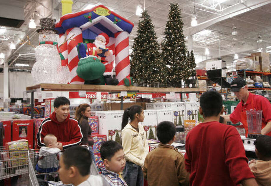Trick-or-treaters are still days away from getting into costume, but the shelves of this Costco in Brooklyn, N.Y., are already stocked with Christmas items. More retailers are expected to join the trend of extending the holiday shopping season this year. Photo: MARK LENNIHAN, AP