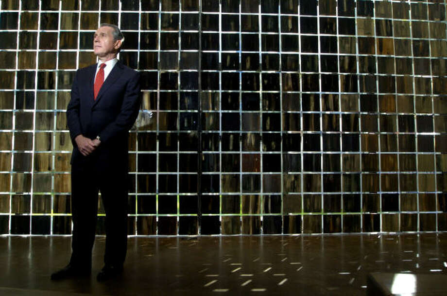 Martin Fein stands in front of the Wall of Tears at the Holocaust Museum Houston. Fein was the museum's first chairman. Photo: Johnny Hanson, For The Chronicle