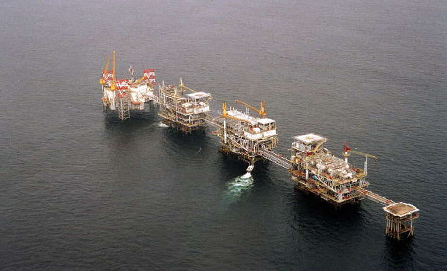 A five-platform complex pumps crude off the coast of Cabinda, Angola. The country's entry into OPEC is a sign of the boom in African oil, despite militant attacks and precarious governments. Photo: BRUCE STANLEY, AP File