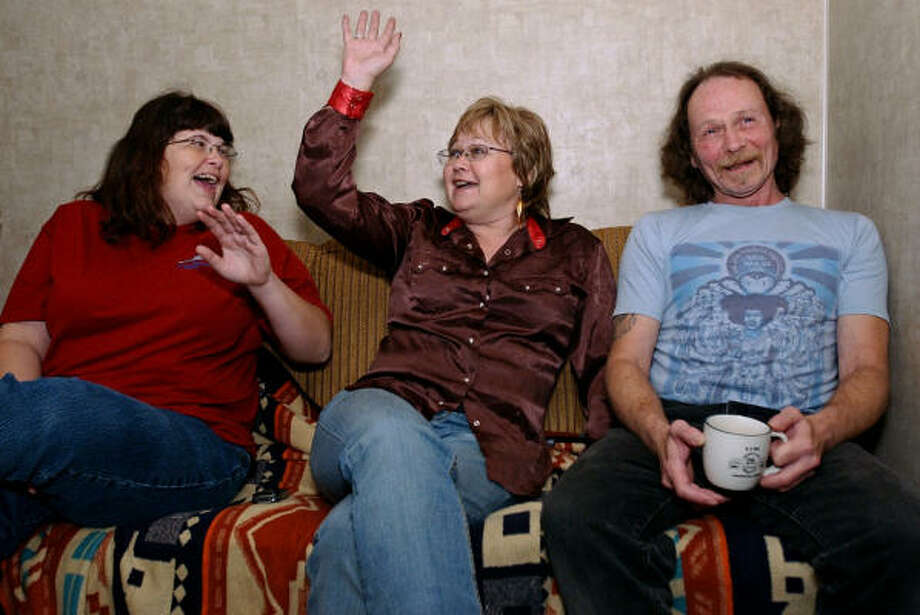 Shanna Adams, left, Sue Hare and their brother, Billy Woolverton, are shown Dec. 19 at their mother's home in Silsbee, Texas. The siblings were recently united. Photo: Mark M. Hancock, Beaumont Enterprise