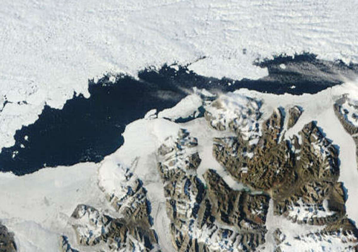 A satellite image of the Ayles Ice Shelf in 2005 shows the collapse in the center. Scientists believe climate changes caused the shelf to break and form a new ice island in the Canadian Arctic.