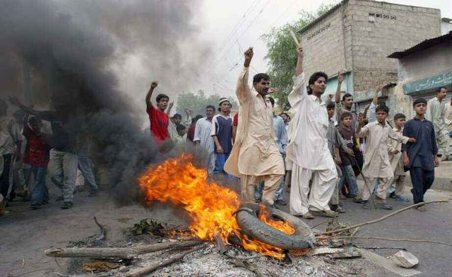 The riots spread from Pakistan's Baluchistan province into neighboring Sindh province on Sunday, where ethnic Baluchis burned tires and chanted slogans in the nation's largest city, Karachi. Police arrested 450 people. Photo: ZAHID HUSSEIN, Reuters
