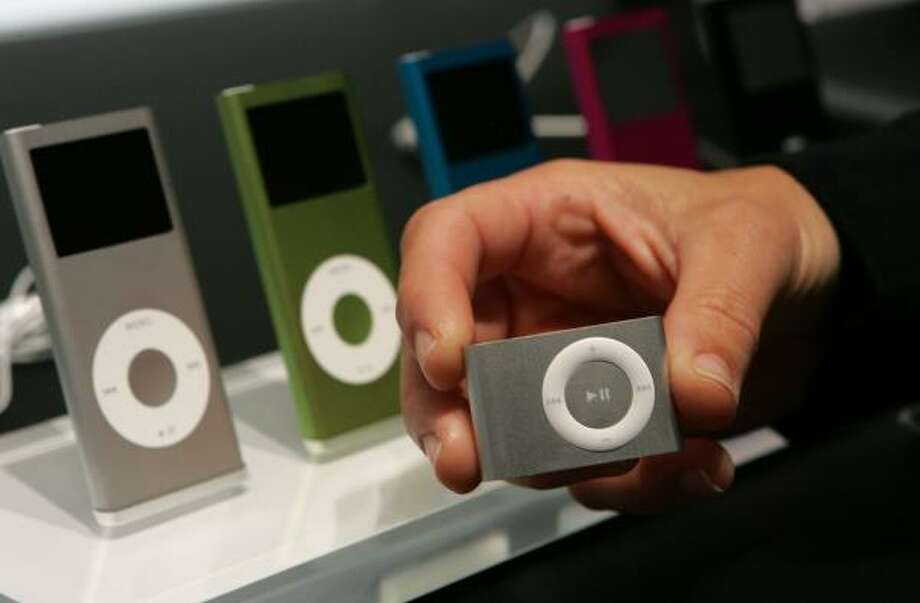 While announcing plans to sell movies over the Internet, Apple on Tuesday also unveiled new models of it's music players, including a smaller iPod shuffle and full-sized iPods with brighter screens. Photo: Justin Sullivan, Getty Images