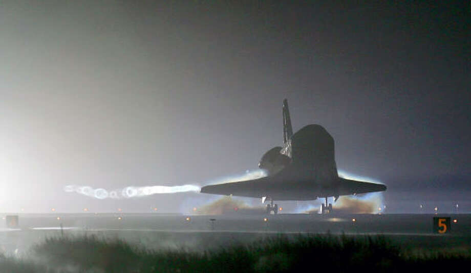 The space shuttle Atlantis lands in pre-dawn darkness Thursday at the Kennedy Space Center in Cape Canaveral, Fla., a day later than scheduled. Photo: Chris O'Meara, REUTERS