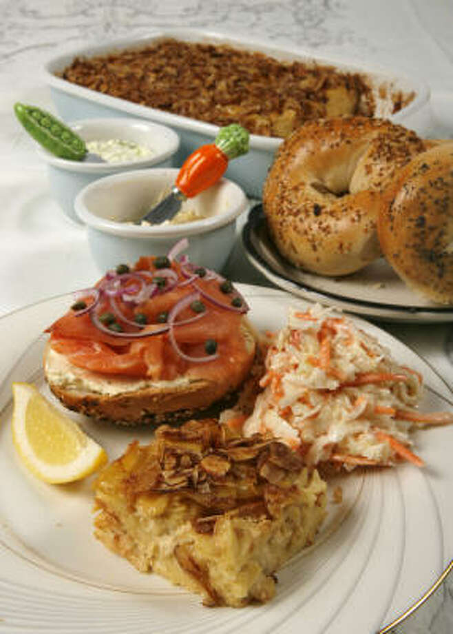 Apricot Noodle Kugel is served with bagels with lox and cream cheese and coleslaw. Photo: Steve Campbell, Chronicle