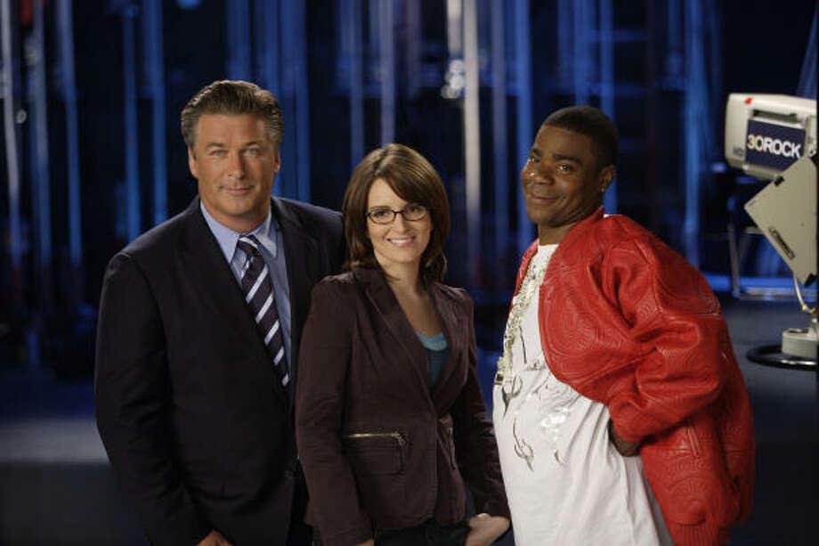 Alec Baldwin as Jack Donaghy, from left, Tina Fey as Liz Lemon, and Tracy Morgan as Tracy Jordan star in NBC's 30 Rock, premiering at 7 p.m. Oct. 11. Photo: Paul Drinkwater, NBC