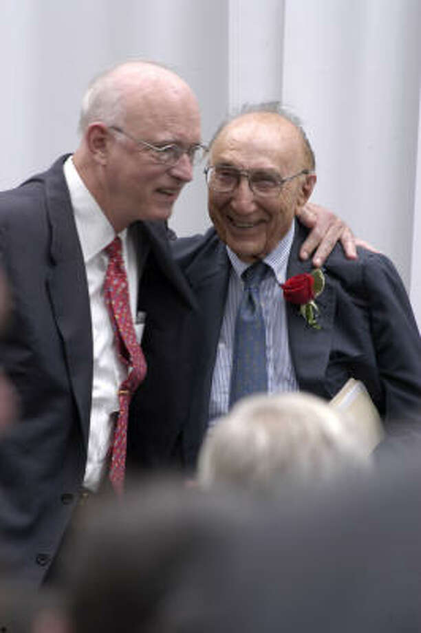 Dr. William Butler, left, chancellor of Baylor College of Medicine, celebrates with Dr. Michael E. DeBakey at the ceremony for renaming the Houston VA medical center  in June of 2004. Photo: CHRONICLE FILE