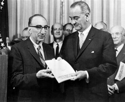 DeBakey presents a report to President Lyndon Johnson in 1964. Photo: CHRONICLE FILE