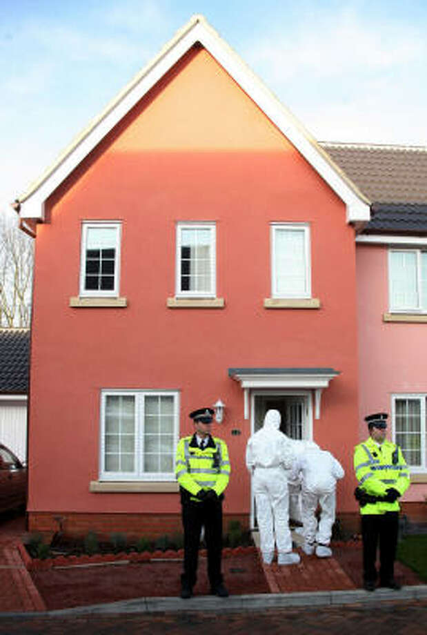 Forensic officers search a house Monday after the arrest of a suspect in the Ipswich slayings. Photo: ANDREW PARSONS, AP